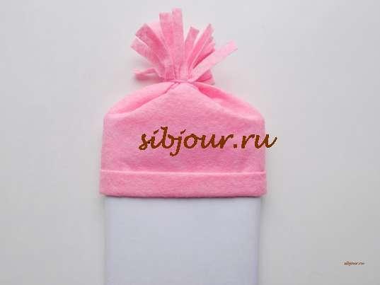 помпон на шапочке снеговика